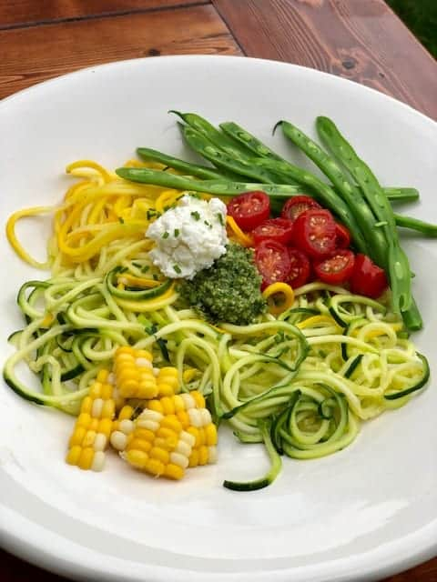 Zucchini Spaghetti with Macerated Tomatoes, Sweet Corn, Green Beans, and Pesto