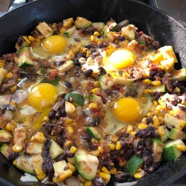 hash with eggs cooking